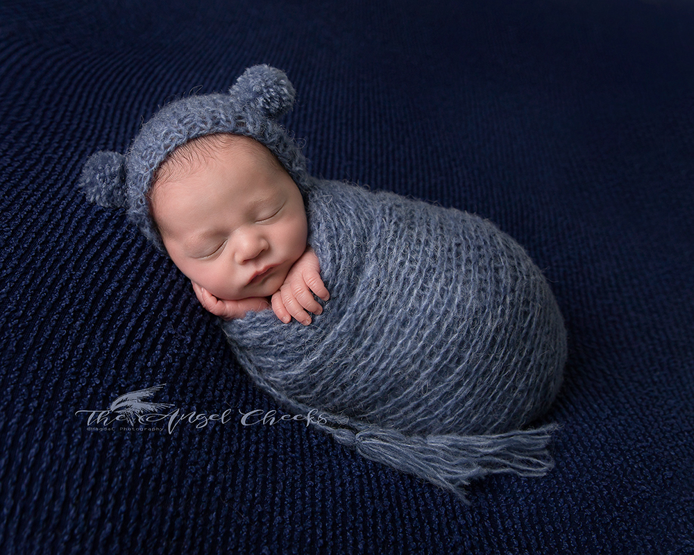 all wrapped newborn baby boy in navy blue photographer in High Wycombe