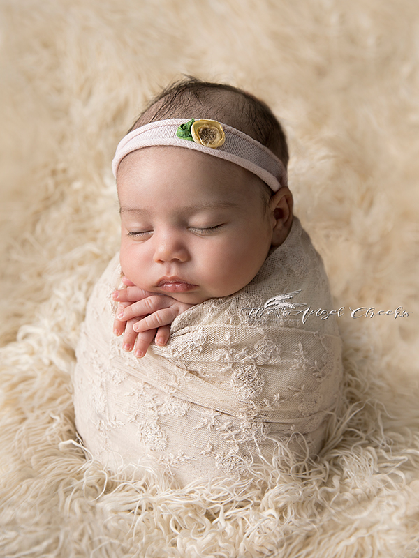 baby posing potato sack highly recommended Newborn Photographer High Wycombe